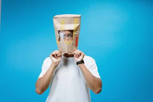 OrangEdge Marketing Home man wearing paper bag on head 3951612 5